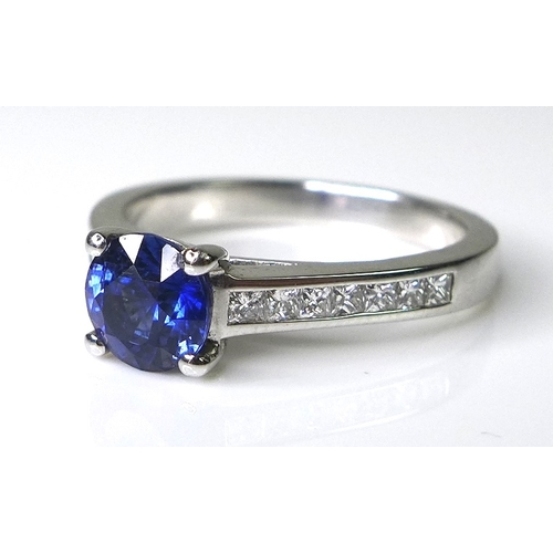 278 - An 18ct white gold and sapphire ring, the 0.9ct brillant cut royal blue sapphire flanked by diamond ...