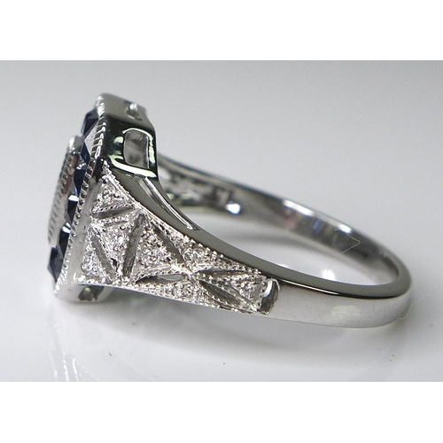 280 - An Art Deco style 18ct white gold, sapphire and diamond ring, two emerald cut diamonds to the centre...