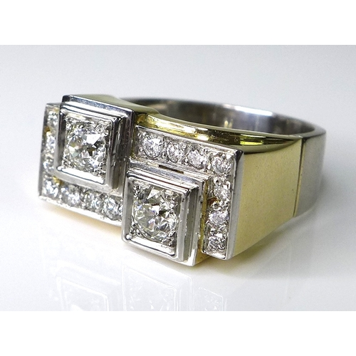 304 - An 18ct gold and diamond Art Deco style ring, formed as two old cut diamonds each of approximately 0...