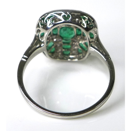 307 - An Art Deco style emerald and diamond ring, formed of brilliant cut diamonds and princess cut emeral...