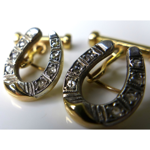 219 - A pair of 14ct gold and diamond cufflinks formed as horseshoes, each set with seven diamonds, with r...