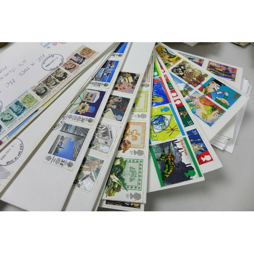 46 - A collection of over seventy first day covers, mostly GB, and seventeen presentation packs and loose...