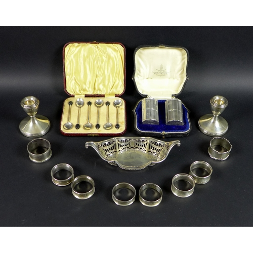 19 - A group of silver items, including a pair of Victorian silver pepper pots, of fluted column form, Ed...