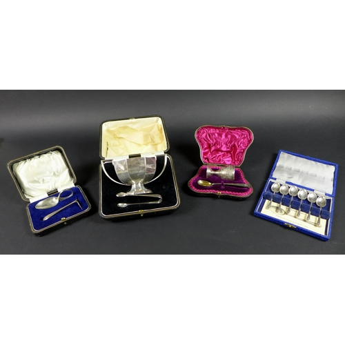 18 - A group of four cased silver Christening sets, including a twin handled sugar bowl, 1922 and tongs, ...