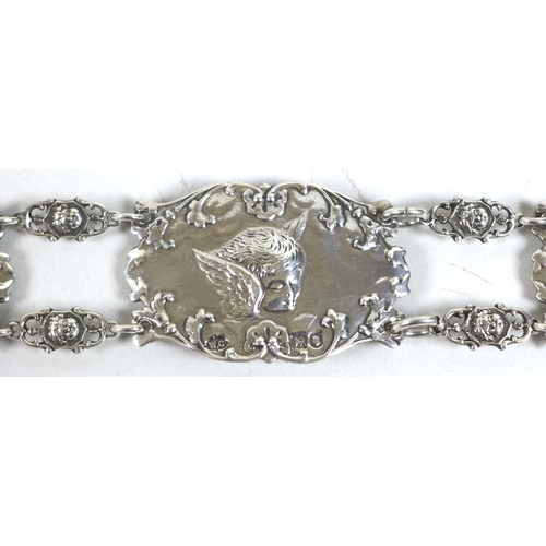 39 - An Edward VII silver christening belt, formed of nine oval plaques each cast in relief with Reynold'...