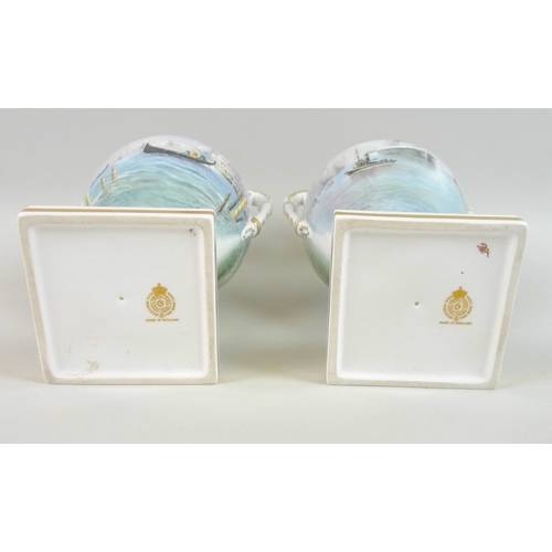 43 - A pair of modern Royal Worcester pedestal vases, twin foliate scrolled handles, one decorated with a...