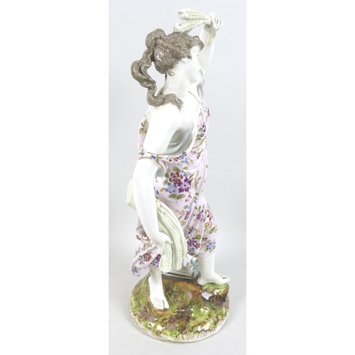 58 - A large 19th century porcelain figurine, emblematic of Summer, modelled as a lady in a pink dress fl...