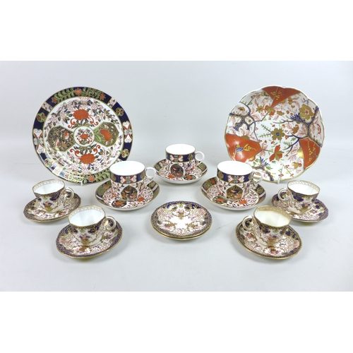 18 - A group of Royal Crown Derby bone china wares, comprising three Birds Imari pattern tea cups with sa...