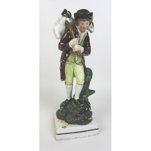 6 - An early 19th century Staffordshire pottery figure, modelled as a shepherd carrying a sheep over his...