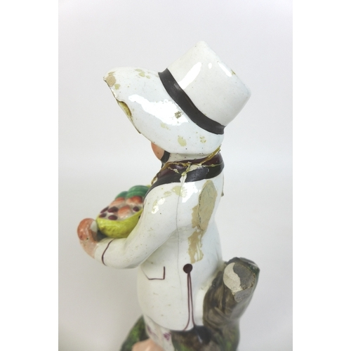 5 - A John Walton Staffordshire pearlware figure, circa 1830, modelled as a baker's boy selling bread fr...