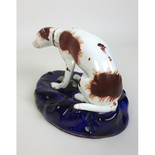 4 - Two Staffordshire figurines, mid 19th century, each modelled as a spaniel, one brown and white in se...