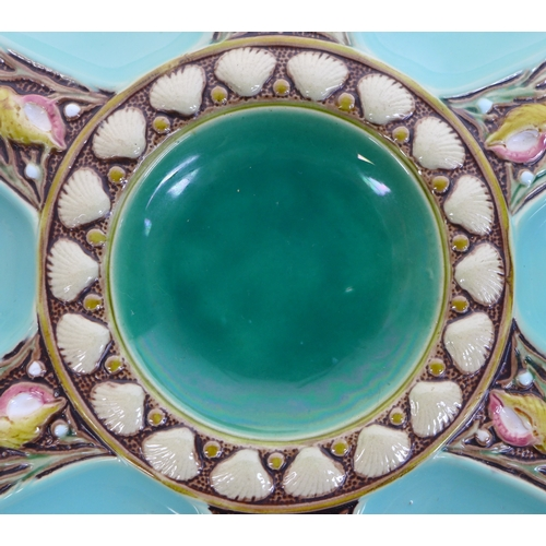 37 - A set of eight Minton majolica oyster plates, circa 1870, shape 1323, each modelled with six shallow...