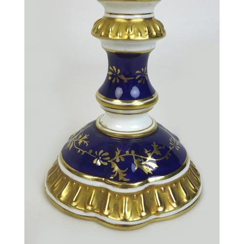 30 - An Edwardian Coalport porcelain goblet-vase, shape 144, modelled with three handles, flared rim, on ...