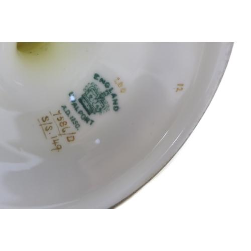 31 - An Edwardian Coalport porcelain ewer, shape 149, modelled with foliate scroll handle, shaped spout, ...