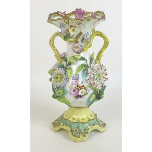 32 - An early 19th century porcelain vase, of baluster form with pierced rim and shaped pedestal base, a ...