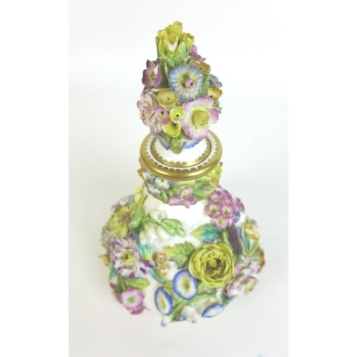 24 - A 19th century porcelain perfume bottle and stopper, possibly Coalport, of squat baluster form, deco...