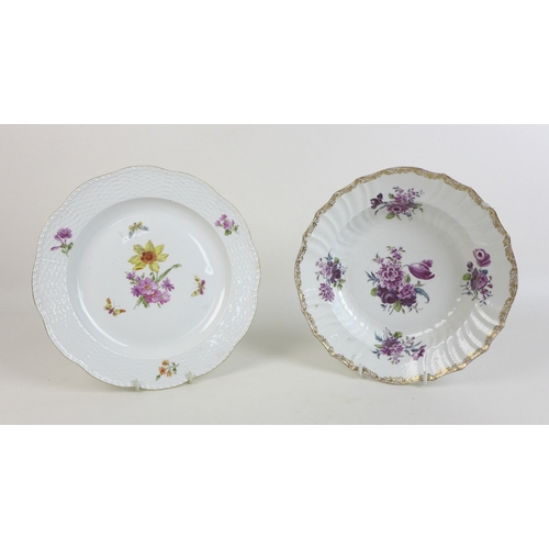 38 - Two early 19th century Berlin factory porcelain dishes, one with frilled moulded rim, decorated with...