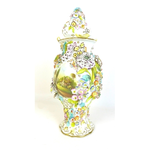 39 - A late 19th century encrusted polychrome porcelain vase and cover, in Coalbrookdale style, of balust...