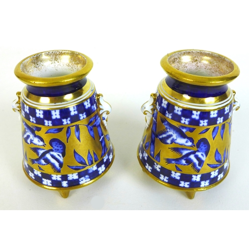 27 - A pair of Edwardian Coalport miniature vases, of baluster form with twin foliate clasped handles, de...