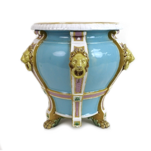 36 - A Minton Majolica jardiniere, late 19th century, decorated with six applied lion masks with rings in...