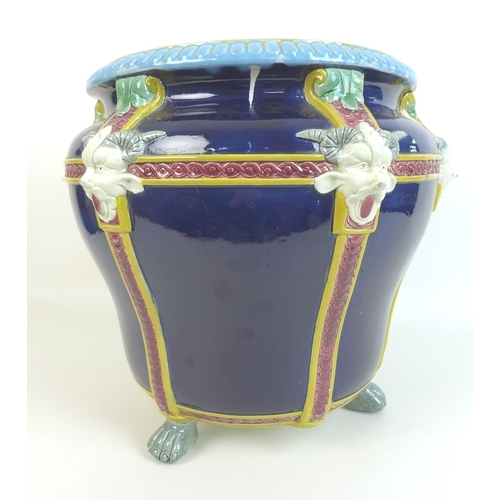 26 - A majolica jardiniere in Minton style, late 20th century, decorated with six applied devil's masks w...