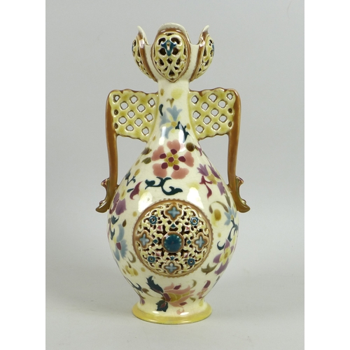41 - A Zsolnay Pecs reticulated porcelain twin handled vase, circa 1885, of baluster form with reticulate...