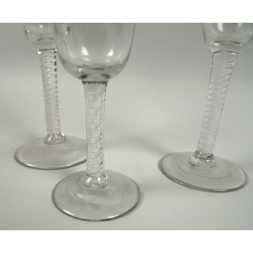 12 - Two Georgian air twist wine glasses, one with flared bowl, 17.2cm high, the other with a rounded fun...