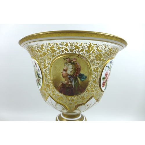 14 - A late 19th century Bohemian glass pedestal vase, of goblet form, decorated with white overlay on cl...