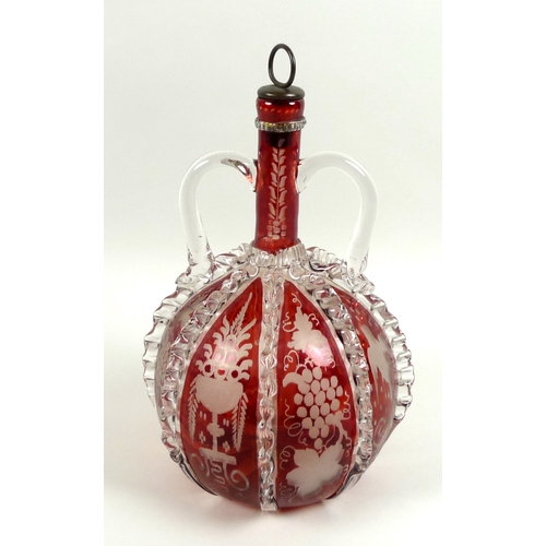 8 - A 19th century cranberry glass decanter, with twin handles, applied clear glass and wheel engraved d...