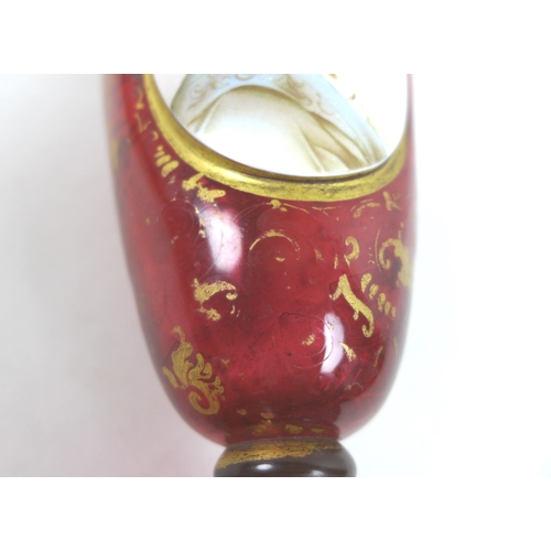 7 - A 19th century Continental cranberry glass vase, of baluster form on circular foot, decorated with a...