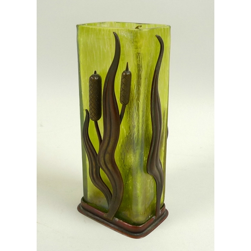 10 - An Art Nouveau iridescent green glass and metal vase, in the style of Loetz, the rectangular section...