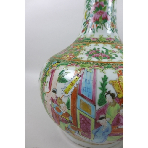 72 - A large Canton porcelain bottle vase, late 19th century, typically decorated with reserves of figure...
