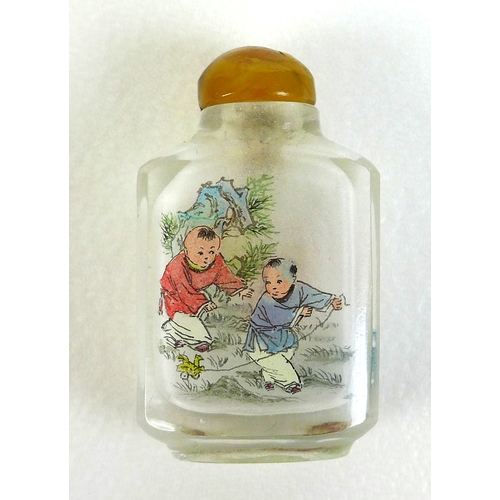 68 - A 20th century Chinese miniature glass snuff bottle, with hand painted decoration featuring two youn...