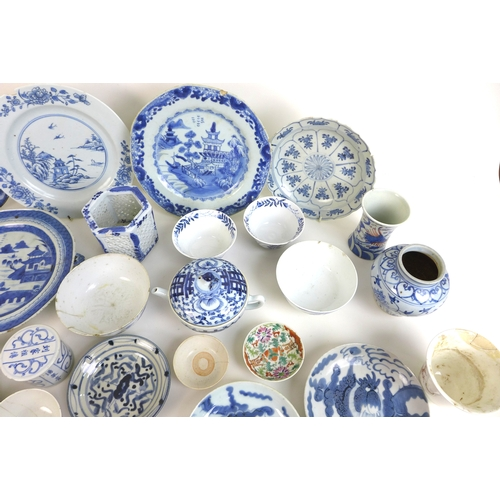 74 - A collection of twenty nine 18th century Chinese porcelain, including a Qianlong brush pot of with w...
