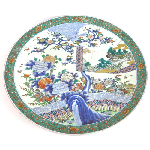 77 - A Chinese porcelain famille verte charger dish, early 20th century, decorated in Kangxi style with b...