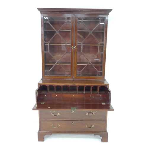 385 - A George III mahogany secretaire bookcase, the upper section with outswept cornice over two astragal...