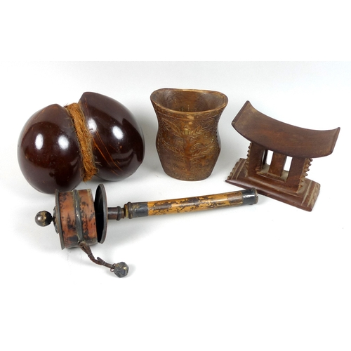 88 - A group of four tribal and eastern wooden collectables, comprising an African or oceanic carved wood...