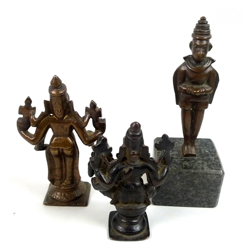 89 - Three bronzed cast metal statues of Hindu deities, a 19th century bronzed metal figural group of Shi...