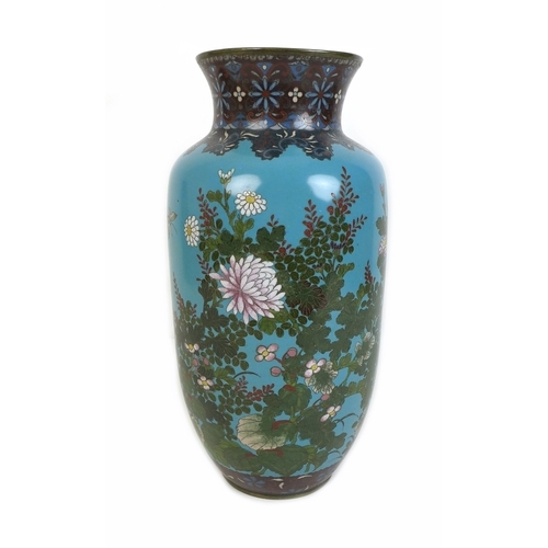 91 - A 19th century Japanese cloisonne lantern form vase, decorated with blossom and butterfiles against ...