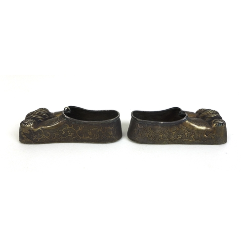 90 - A pair of Chinese Qing style shoe form brush washers, with embossed, inlaid and gilt decoration, eac...