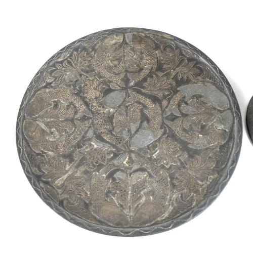 93 - A 19th century eastern bronzed dish with copper inlaid fish design, 17.5cm diameter, together with a...