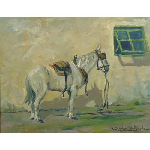 282 - Carlos Sitorla (?) (Spanish School, 20th century): a horse standing by a white painted wall with a g...