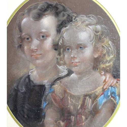 240 - A 19th century pastel portrait of a lady, 58cm oval, together with another pastel portrait of two yo...