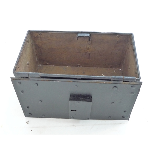 302 - A 17th or 18th century heavy cast iron strong box or 'Armada' chest, with two working replacement ke...