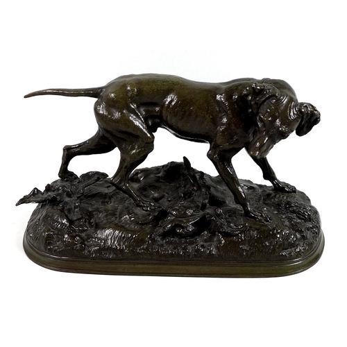 130 - After Jules Moigniez (French, 1835-1894): a bronze sculpture modelled as a pointer, on oval naturali...