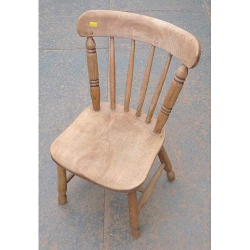16 - A child's oak Windsor side chair, mid 20th century, spindle back, bowed rail, shaped solid seat, tur...