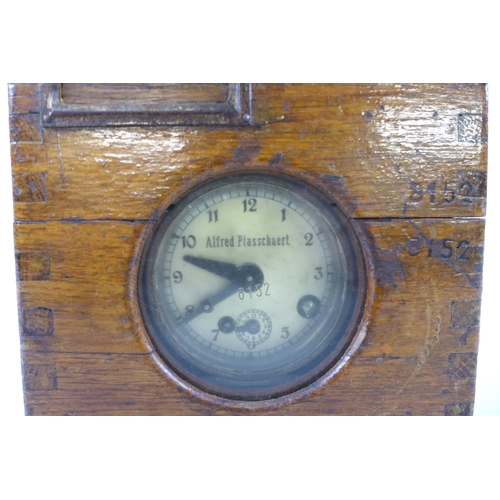 19 - An Alfred Plasschaert Ghent pigeon racing timing clock, numbered '8152', in a dove tailed oak case, ...