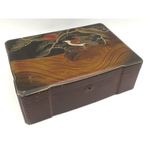 28 - A Japanese lacquered box, early 20th century, the lid decorated with a bird of prey beneath a pine t...