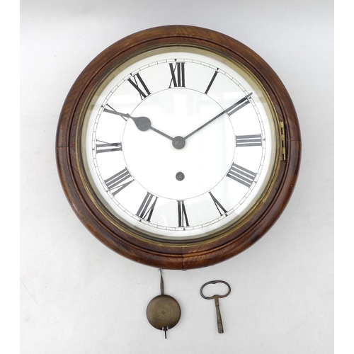 41 - A 19th century oak cased school clock, with Roman numeral dial, movement stamped W & H, 32cm diamete...