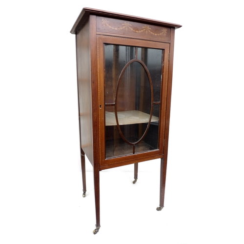 37 - An Edwardian music cabinet with glazed door, and two bentwood cane seated chairs. (3)...